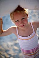 Portrait of a girl 6_7 years at beach of Santa Giulia, Corsica, France