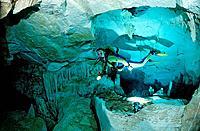 Scuba diver in underwater cave Cueva Taina, Punta Cana, Freshwater, Dominican Republic