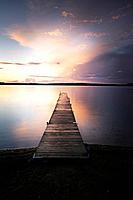Jetty at a lake at sunrise Madkroken near Vaexjoe, Smaland, Sweden