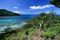People enjoying the view over Dinghy Bay on Brampton Island, Whitsunday Islands, Great Barrier Reef, Australia