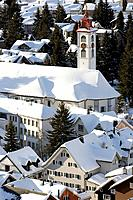 View to snow covered Parish Church St. Peter and Paul, Andermatt, Canton Uri, Switzerland