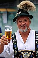 Portrait of a mature Bavarian holding a glass of beer, Munich, Germany