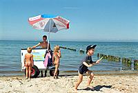 Iceman and children, western beach of Darss, Fischland_Darss_Zingst, Mecklenburg_Western Pomerania, Germany
