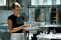 A waitress carrying glasses in Restaurant Lasalle, Zurich, Switzerland