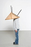 Man with chair on his head (thumbnail)