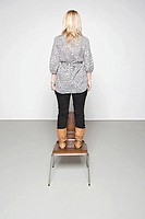Woman standing on a chair