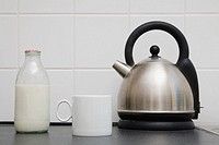 Kettle with cup and milk