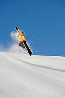 A man snowboarding