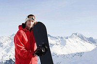 Portrait of a man holding a snowboard