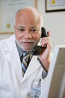 A doctor using the phone