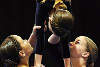 Gymnasts holding girl