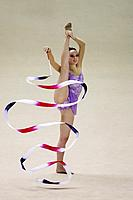 A young woman performing rhythmic gymnastics with ribbon