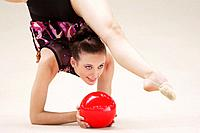 Rhythmic gymnastics, girl doing routine with ball