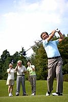 People playing golf at golf course