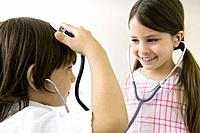 Children playing with stethoscopes