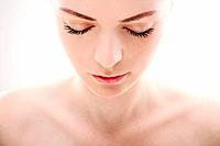 Woman looking down with her eyes closed (thumbnail)