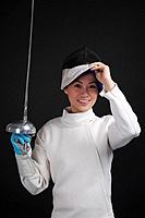 Woman with fencing foil posing for the camera (thumbnail)