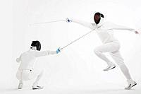 Two men fencing