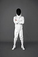 Man in fencing suit posing for the camera
