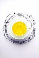 A cup of tea surrounded by barbed wire