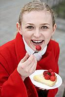 Woman enjoying strawberry tart (thumbnail)