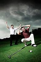 Men playing golf at golf course