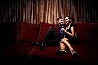 Man and woman sitting on the couch talking