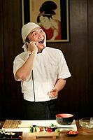 Chef talking on the phone while preparing food