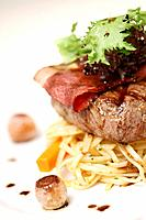 Steak with bacon and linguine