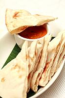 Naan bread with curry dip