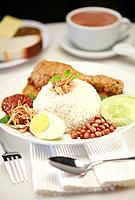 Nasi lemak with chicken rendang