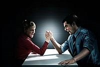 Business people arm wrestling (thumbnail)