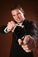 Businessman using slingshot