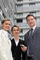 Business people smiling at the camera (thumbnail)
