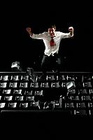 Businessman jumping on computer keyboard