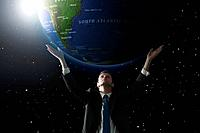 Businessman lifting up a globe