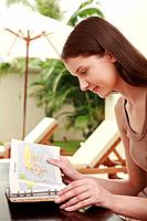 Woman looking at map in organizer