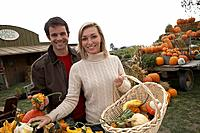Couple looking at organic squash, Ladner, British Columbia, Canada