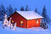 La Nictale shelter and snow-covered trees at twilight, Quebec, Canada