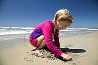 5 year old girl playing at a beach, San Diego California