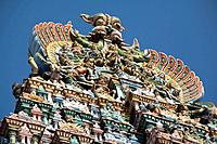 Carved figures on top of a gopuram, Meenakshi Temple, Madurai, Tamil Nadu, India Date: 15/05/2008 Ref: ZB362_115569_0023 COMPULSORY CREDIT: World Pict...