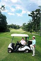 Man in golf cart talking to his friend