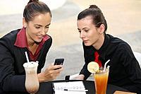 Businesswomen reading at a text message