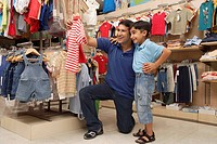 father and son shopping for clothes