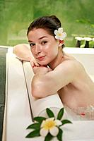 Woman in bathtub smiling at the camera