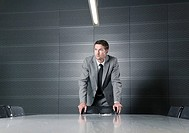 Businessman standing in a meeting room