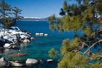 High angle view of a man kayaking in a lake, Lake Tahoe, Nevada, USA