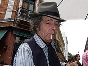 Mature man smoking a cigarette, Buenos Aires, Argentina