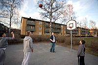 Boys´ playing basketball