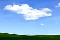 Fields and cloudy blue sky